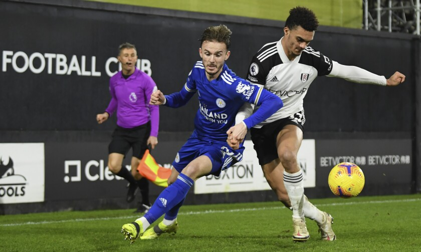 Leicester's Ricardo Pereira, left, duels for the ball with Fulham's Antonee Robinson during the English Premier League soccer match between Fulham and Leicester City at the Craven Cottage stadium in London, Wednesday, Feb. 3, 2021. (Mike Hewitt/Pool via AP)