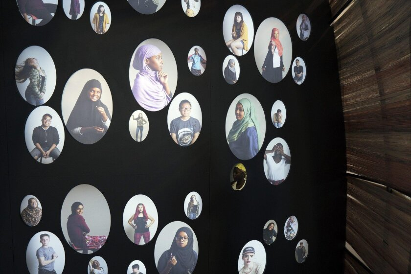 """The AjA Project's installation """"Inter+FACE"""" at the San Diego Museum of Man."""