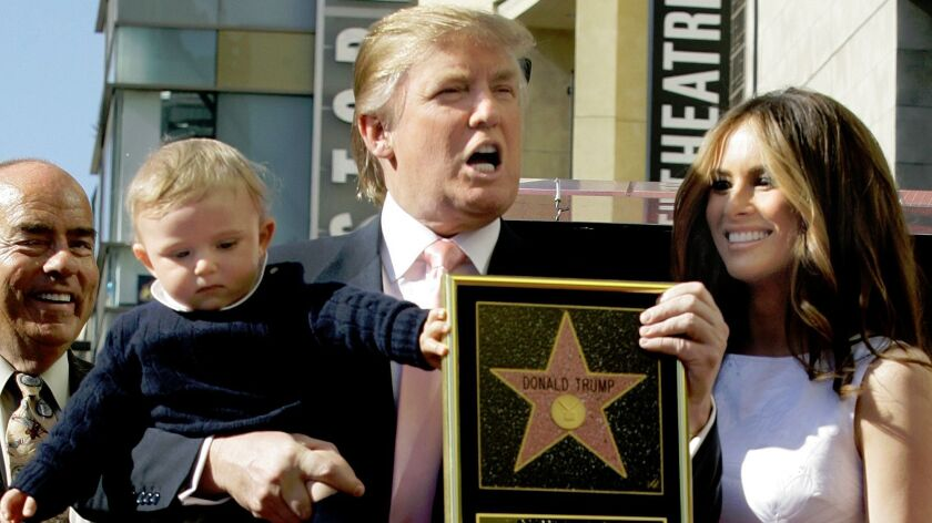 Donald Trump and his wife, Melania, and their son, Barron, posed for a photo after he was given a star on the Hollywood Walk of Fame in 2007.