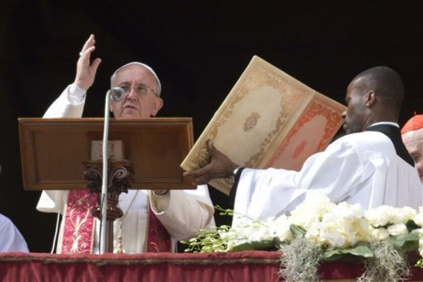 Pope Francis delivers the Urbi et Orbi (to the city and to the world) blessing at the end of his first Easter Sunday Mass in St. Peter's Square at the Vatican Sunday, March 31, 2013. Pope Francis celebrated his first Easter Sunday Mass as pontiff in St. Peter's Square, packed by joyous pilgrims, to