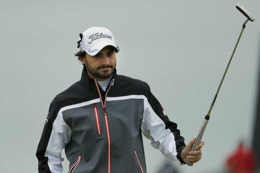 Clement Sordet of France raises his club on the 7th green, wearing a cap that has the words 'Pray for Nice' written by hand on it, during the second round of the British Open Golf Championship at the Royal Troon Golf Club in Troon, Scotland, Friday, July 15, 2016. France was ravaged by its third at