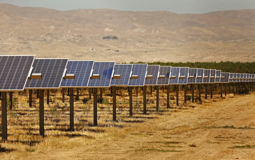 The 20-megawatt Maricopa West solar project, surrounded by almond groves, was built on Kern County farmland.