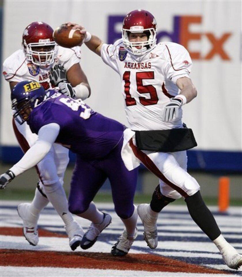 Arkansas quarterback Ryan Mallett (15) passes as tackle DeMarcus Love, top left, blocks East Carolina defensive tackle Maurice Mercer in the first quarter of the Liberty Bowl NCAA college football game on Saturday, Jan. 2, 2010, in Memphis, Tenn. (AP Photo/Mark Humphrey)