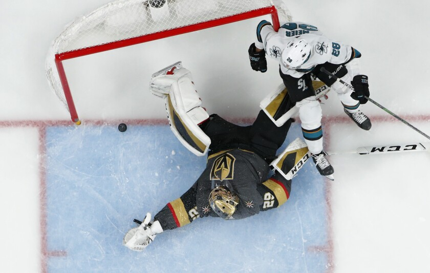San Jose Sharks right wing Timo Meier (28) falls into the net after scoring against Vegas Golden Knights goaltender Marc-Andre Fleury (29) during the second period of an NHL hockey game Thursday, Nov. 21, 2019, in Las Vegas. (AP Photo/John Locher)