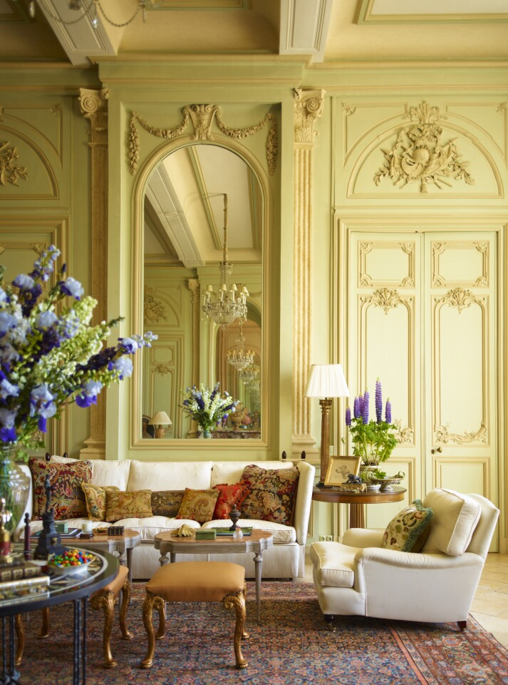 """The cover image for Timothy Corrigan's new book is the Grand Salon of Chateau du Grand-Luce. The designer says his goal was to """"create a setting that was somewhat more casual and light-handed than one would normally expect to find in a building that has been called one of the finest examples of neo-classical architecture in France."""" The interiors intentionally mix antiques with the kind of comfortable sofas and chairs one might see in a contemporary home. """"If I decked out the Grand Salon with proper groupings of little gilt-wood chairs and settees,"""" he writes, """"we'd never have any fun -- and nobody would ever want to come back."""""""