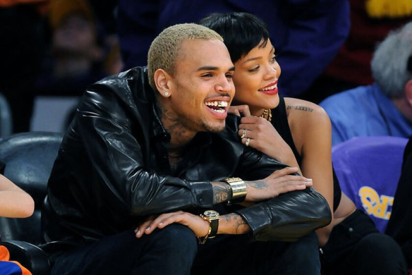 Chris Brown and Rihanna hung out together as the Lakers played the New York Knicks at Staples Center on Christmas Day.