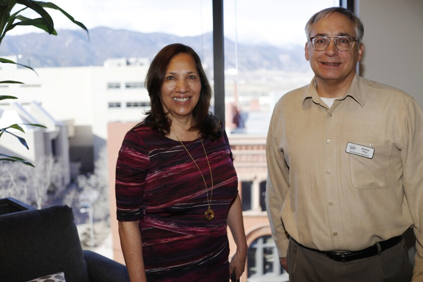 In this Dec. 13, 2019, photograph, Colorado Springs, Colo., council members Yolanda Avila and Andres Pico are shown in a city office in Colorado Springs, Colo. Hispanic voters are heavily Democratic but Hispanic men are more likely to vote Republican than Hispanic women. This gender gap is roughly the same size as the one among white voters. Avila and Pico are friends who sit next to each other on the Colorado Springs' city council. But politically the two couldn't be further apart, Avila is a durable Democrat and Pico an unflinching Republican. (AP Photo/David Zalubowski)