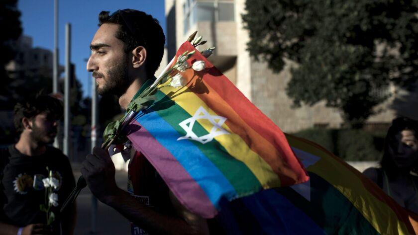 A patriotic gay pride flag is displayed.