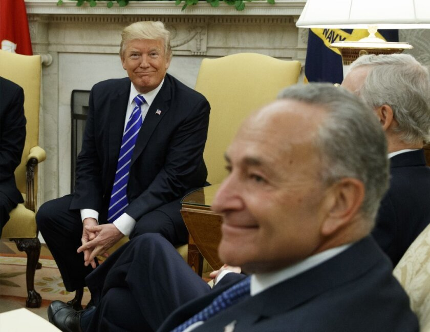 President Donald Trump and Senate Minority Leader Chuck Schumer, D-New York, are shown during a 2017 meeting in which a compromise on immigration laws was discussed. A compromise on guns could help both.