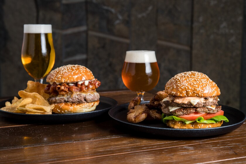 Where's the beef? At Stone's bistros, where the menu now includes True Craft Burger, paired with Enter Night pilsner, left, and The Burger, shown with Stone Scorpion Bowl IPA, right.