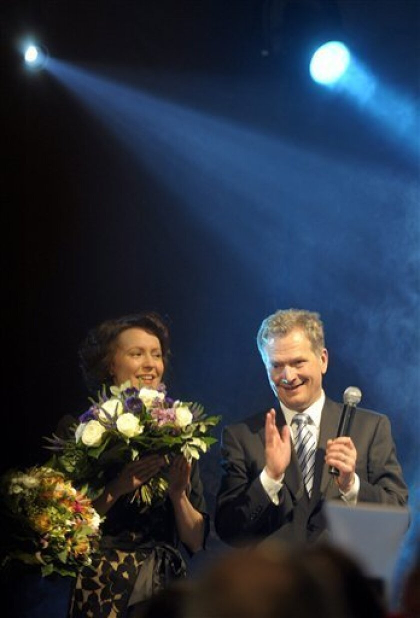 Sauli Niinisto, the Finland's presidential candidate of the National Coalition Party and and his wife Jenni Haukio at an election night rally at the Finlandia Hall in Helsinki, Finland Sunday Feb. 5, 2012 after the results of the second and final round of vote is counted. A former finance minister won Finland's presidential election Sunday and was poised to become the country's first conservative head of state in five decades. Sauli Niinisto won 63 percent of the votes, compared to 37 percent for his rival, Greens candidate Pekka Haavisto, official results showed with 100 percent of ballots counted. (AP Photo/Lehtikuva/Heikki Saukkomaa) FINLAND OUT. NO SALES. ***