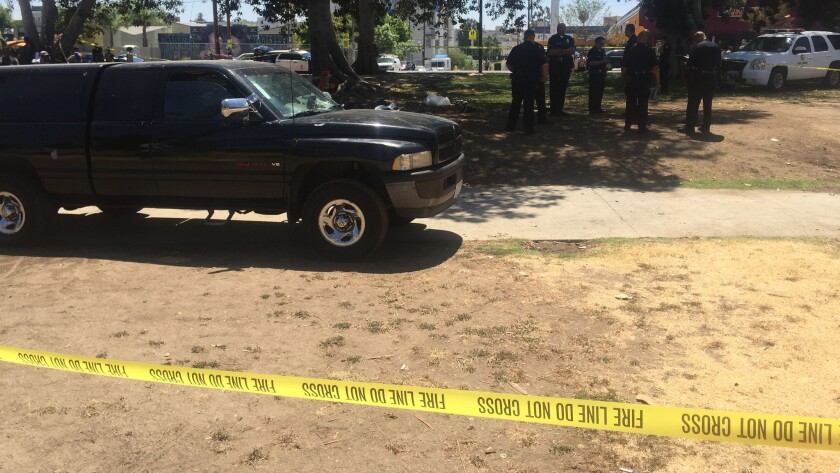 Police investigate the crash in MacArthur Park.