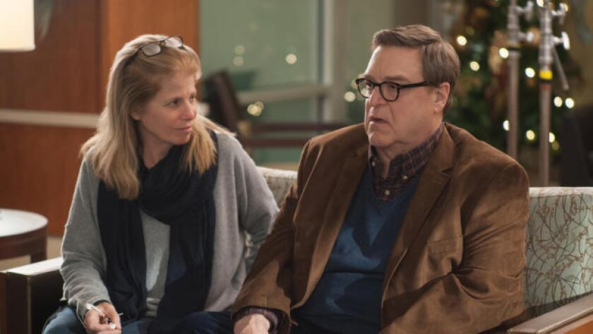 """Jessie Nelson with John Goodman on the set of the film """"Love the Coopers."""""""