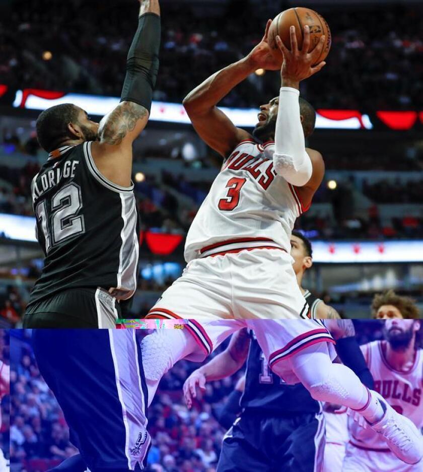 El jugador de Bulls Dwyane Wade (d) se dirige a la cesta ante la marca de LaMarcus Aldridge (i), de Spurs, durante el partido. EFE