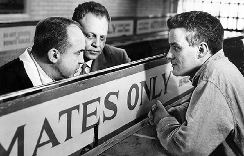 Mickey Cohen, left, flanked by attorney Norman Sugarman, visits Sam LoCigno in county jail on March 30, 1960. LoCigno was convicted of first degree murder in killing of Jack Whalen.