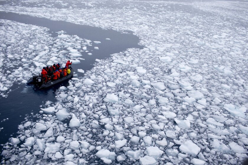A Zodiac carrying a team of international scientists heads to Chile's station Bernardo O'Higgins, Antarctica in January. Western Antarctica's sea-based ice shelves, which buttress land ice, have begun melting 70% faster in the decade, a new study suggests.