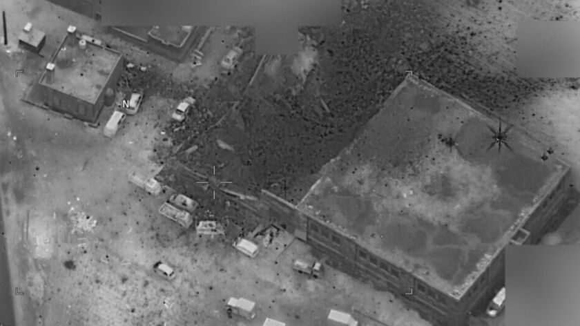 """Photo of compound in Al Jinah, Syria where the U.S. military launched an airstrike Mar. 16 on Al Qaeda leaders. The Pentagon says it left mosque, located at the upper left edge of the photo, """"relatively unscathed."""""""