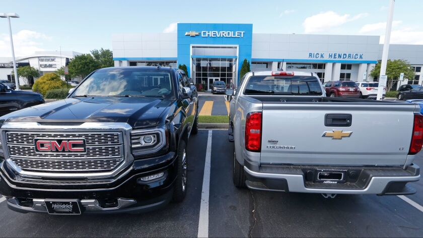 In this Wednesday, April 26, 2017, photo, vehicles are lined up in front of a Chevrolet dealership i
