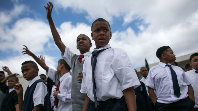 Students stand in line during an assembly at the Boys Academic Leadership Academy in South LA. on Aug. 15. (Robert Gauthier/Los Angeles Times)