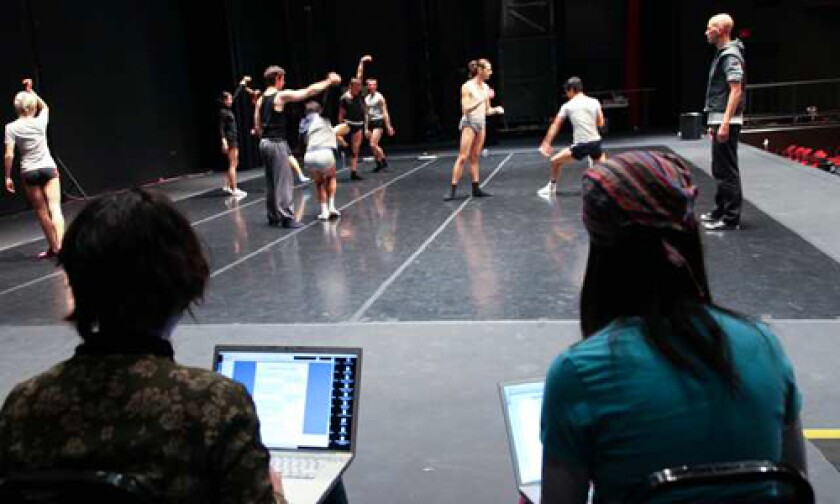 WATCH MEN: Students using laptops take notes on dancers' movements as Random Dance Company's Wayne McGregor observes, far right.