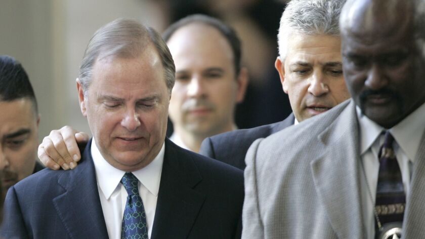 Jeffrey Skilling, left, was initially sentenced in 2006 to 24 years in prison. In 2013, the sentence was reduced.