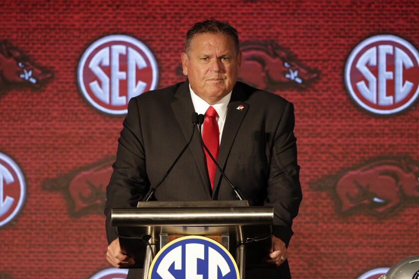 FILE - Arkansas head coach Sam Pittman speaks to reporters during an NCAA college football news conference at the Southeastern Conference media days in Hoover, Ala., in this Thursday, July 22, 2021, file photo. Arkansas is feeling good about coach Sam Pittman after last season's 3-7 campaign produced much more competitive football than in recent years. (AP Photo/Butch Dill, File)