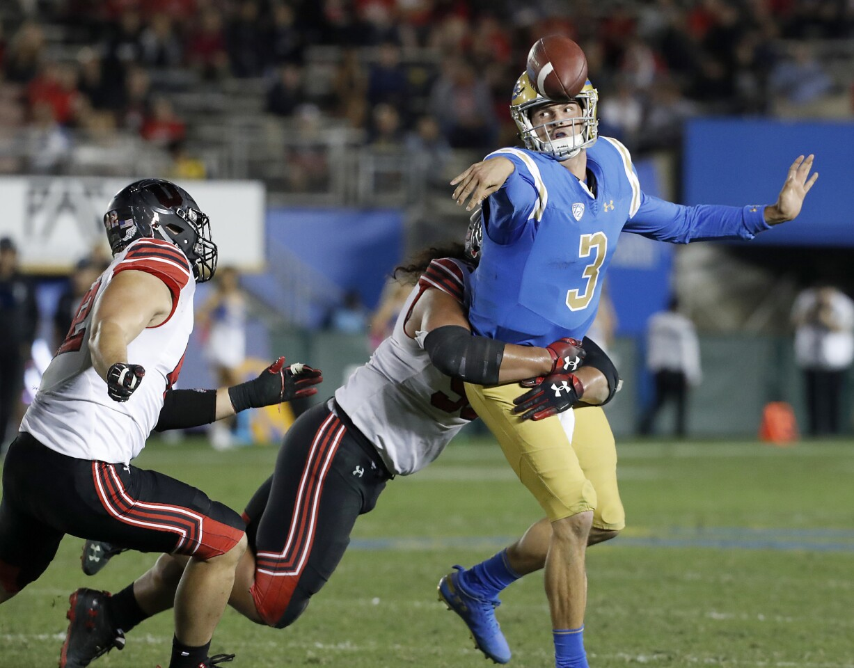 UCLA quarterback Wilton Speight, under pressure from the Utah defense, is forced to get rid of the ball in the fourth quarter.