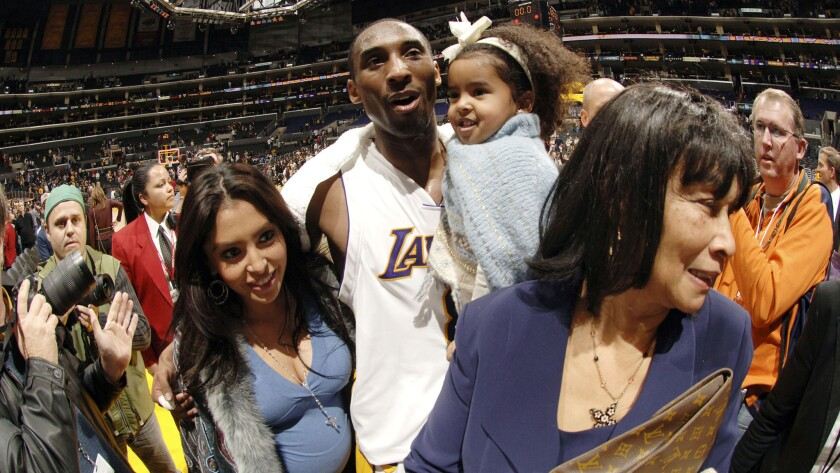 Kobe Bryant exits the court with wife Vanessa and daughter Natalia after scoring 81 points