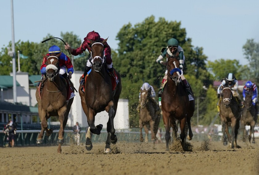 Shedaresthedevil crosses the finish line ahead of Swiss Skydiver, left, and Gamine to win.