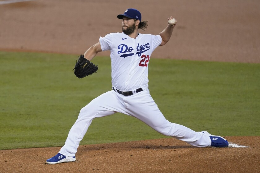 Dodgers starter Clayton Kershaw delivers during the first inning against the Angels at Dodger Stadium.