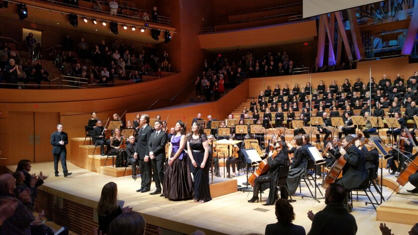 Conductor Grant Gershon, far left, of the L.A. Master Chorale, joins singers Rod Gilfry, Arnold Livingston Geis, Allyson McHardy and Raquel Gonzalez, for a bow at Disney Hall.