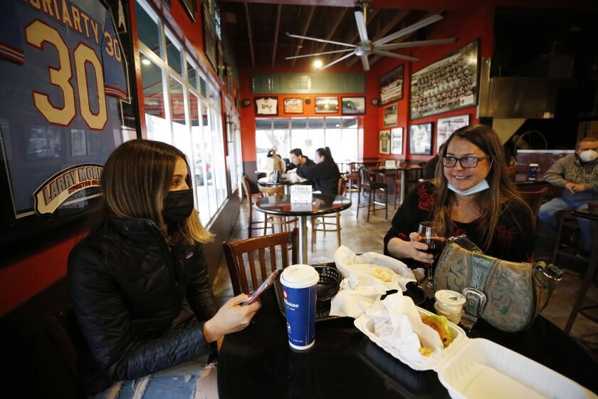 Two women eat lunch in San Luis Obispo.