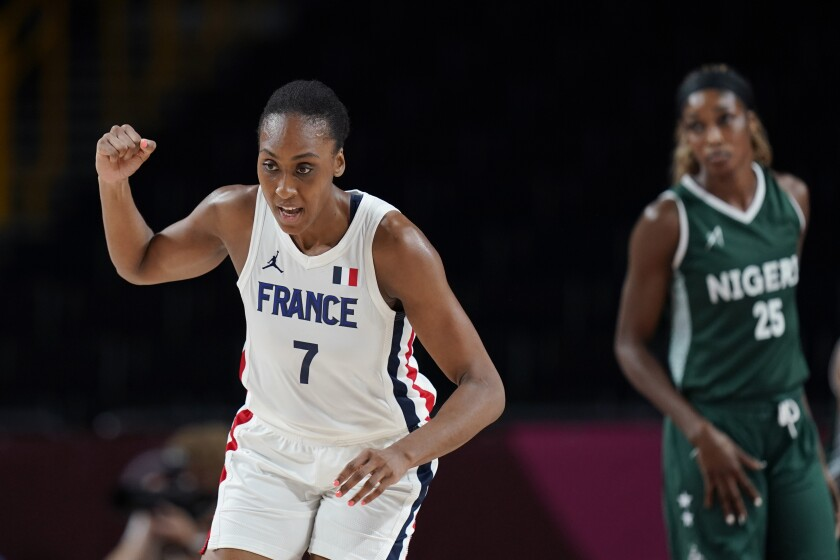 France's Sandrine Gruda (7) celebrates a score against Nigeria during a women's basketball game at the 2020 Summer Olympics, Friday, July 30, 2021, in Saitama, Japan. (AP Photo/Eric Gay)