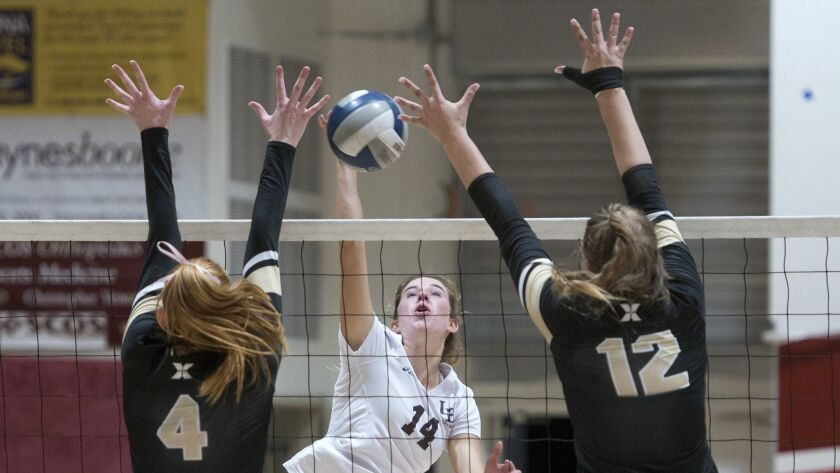 Laguna Beach outside hitter Piper Naess hits the ball during a first-round CIF-SS Division II playof