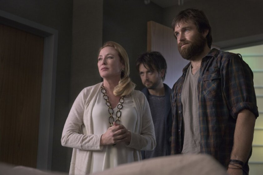"""Virginia Madsen, Justin Chatwin, and Antony Starr star in the new CBS drama """"American Gothic"""""""