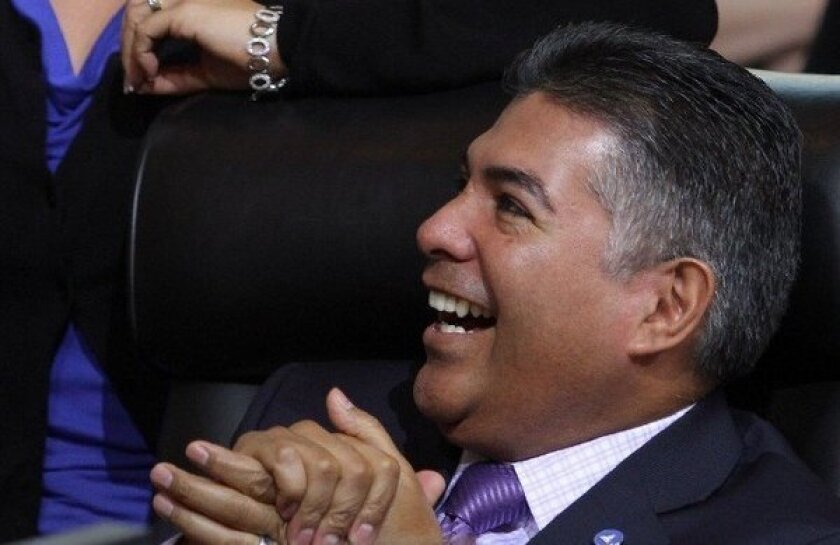 Tony Cardenas, then a Los Angeles city councilman, watches a farewell video at his final council meeting in December 2012 before being sworn in to the House of Representatives in January.