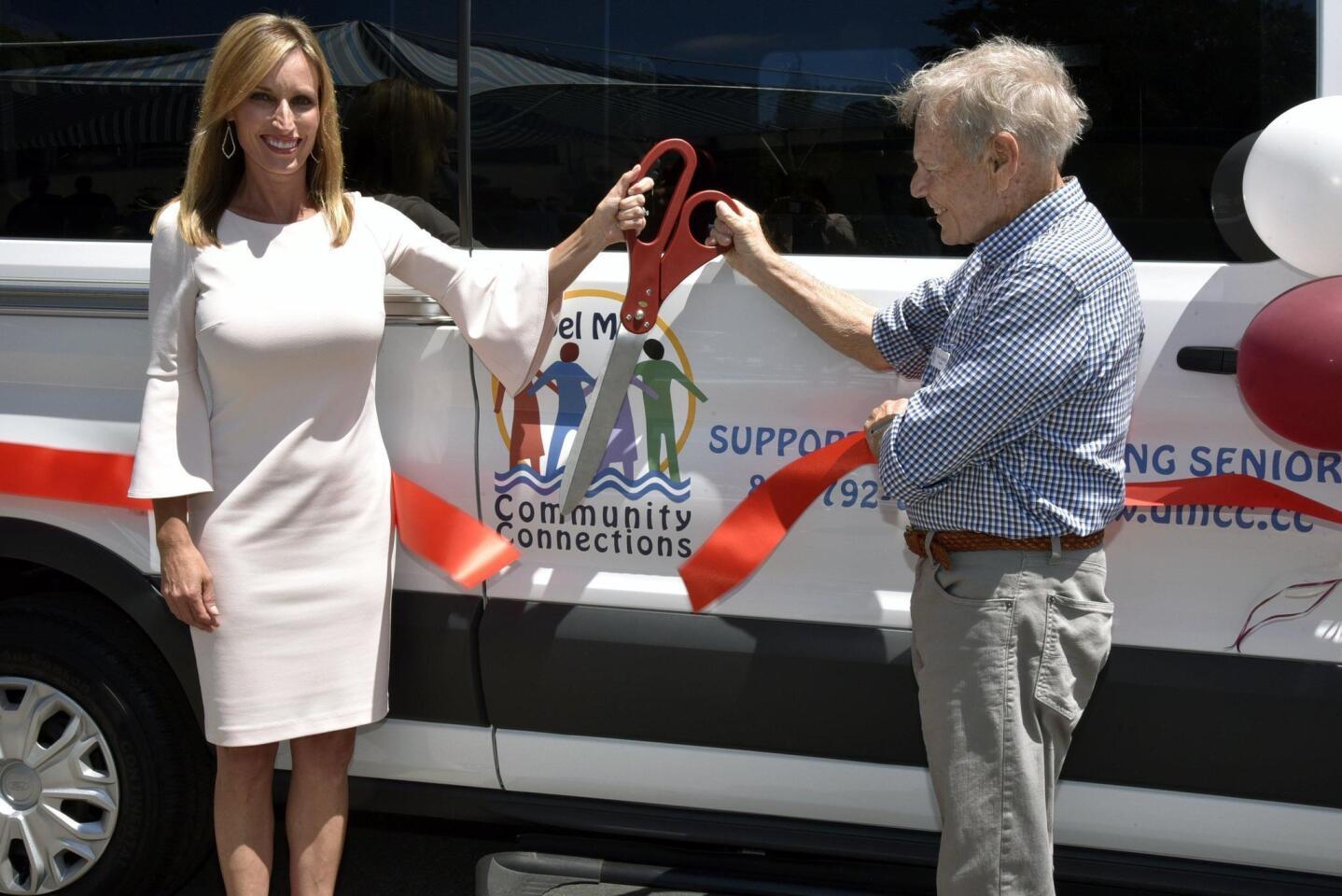 San Diego County Board of Supervisors Chairwoman Kristin Gaspar and DMCC President Terry Kopanski cutting the ribbon for the van dedication