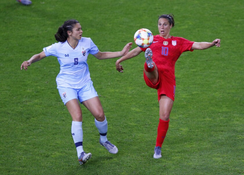 United States' Carli Lloyd attempts to control the ball as Thailand's Miranda Nild , left, watches d