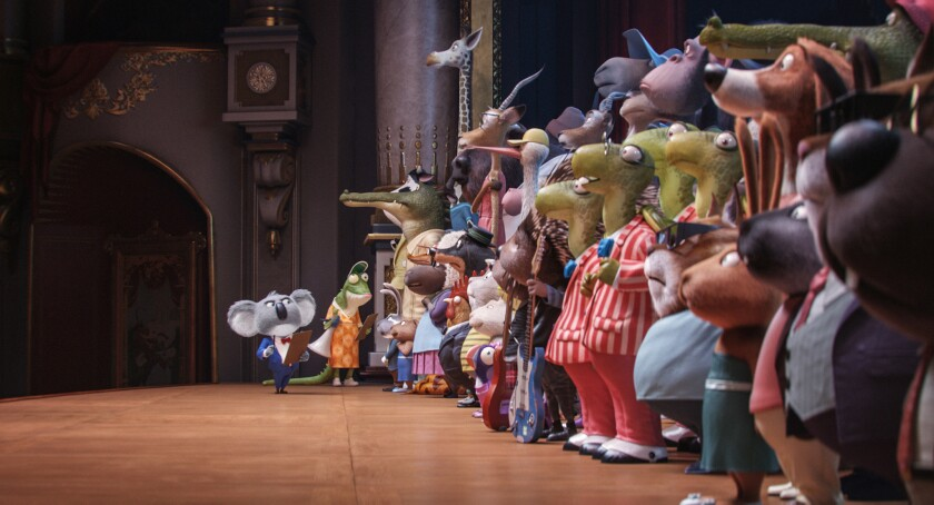 "Academy Award-winner Matthew McConaughey, voices dapper koala Buster Moon, right,  and writer-director Garth Jennings  as elderly lizard Miss Crawly greet the contestants in the event film ""Sing,"" from Illumination Entertainment and Universal Pictures."