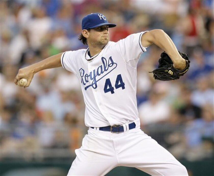 Kansas City Royals starter Luke Hochevar delivers during the fifth inning of a baseball game against the Seattle Mariners on Friday, July 11, 2008, in Kansas City, Mo. (AP Photo/Charlie Riedel)