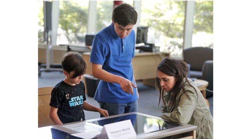 La Canada High School 7/8 seventh-grader Devyn Oh helps explain Minecraft: Education Edition to Zhan