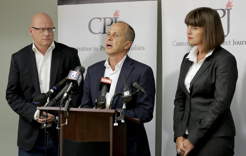 Al Jazeera journalist Peter Greste, center, answers questions during a news conference along with journalist Sue Turton, right and senior producer Dominic Kane, Tuesday, Sept. 29, 2015, in New York. The three are in the process of requesting a pardon from Egyptian President Abdel Fatah al-Sissi after having been convicted in absentia by Egypt's courts of aiding terrorist organizations by disseminating false news. (AP Photo/Julie Jacobson)