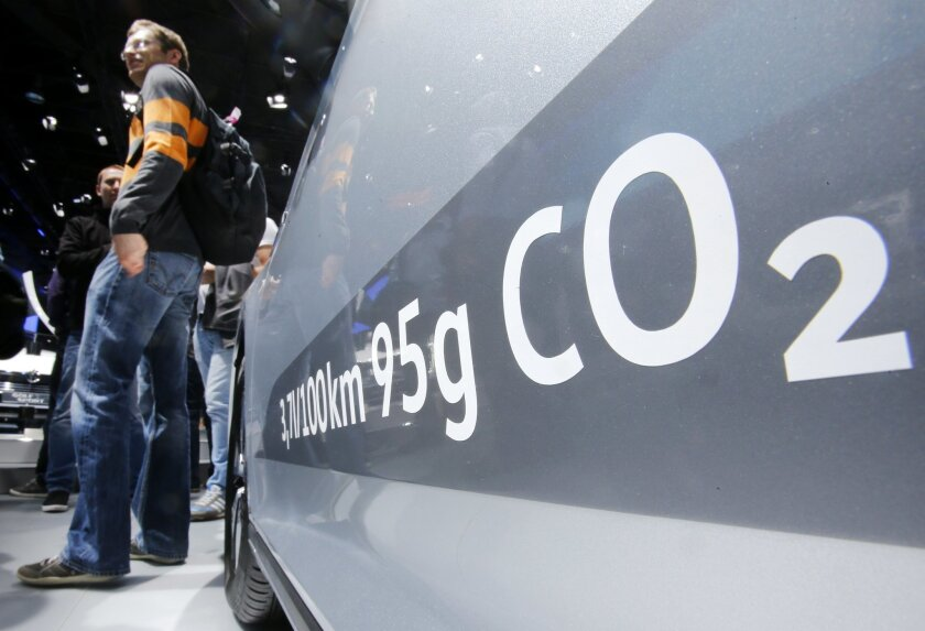 The amount of carbon dioxide emission is written on a Volkswagen Passat Diesel at the Frankfurt Car Show in Frankfurt, Germany, Tuesday, Sept. 22, 2015. Volkswagen has admitted that it intentionally installed software programmed to switch engines to a cleaner mode during official emissions testing. The software then switches off again, enabling cars to drive more powerfully on the road while emitting as much as 40 times the legal pollution limit. (AP Photo/Michael Probst)