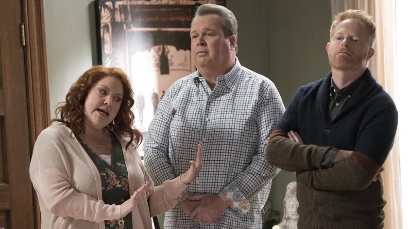 "Dana Powell, Eric Stonestreet and Jesse Tyler Ferguson in ""Modern Family"" on ABC."