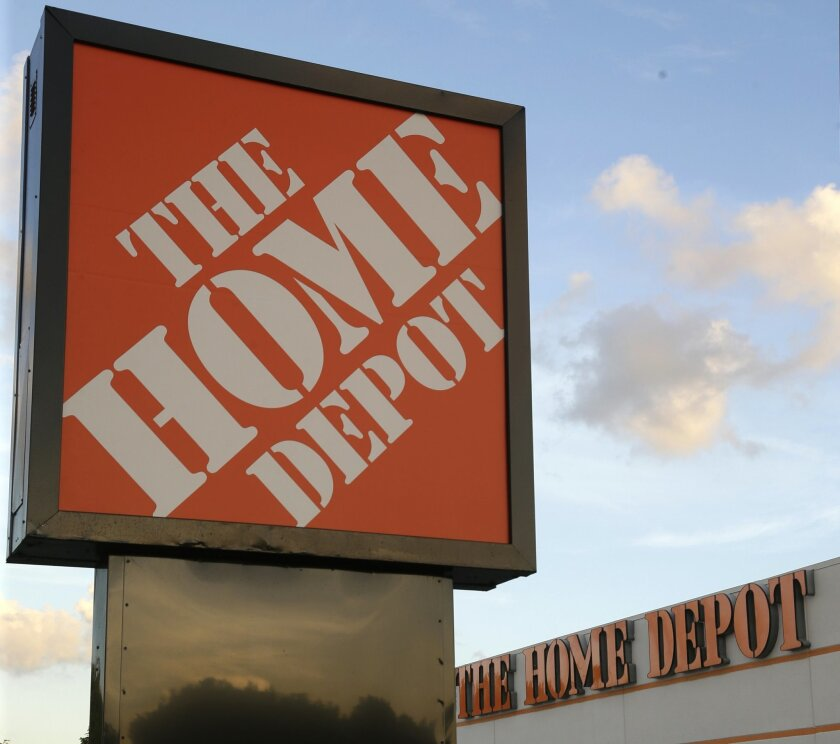 This Monday, Nov. 17, 2014 photo shows a Home Depot store is shown in Hialeah, Fla. Home Depot reports quarterly financial results before the market opens Tuesday, Feb. 24, 2015. (AP Photo/Wilfredo Lee)
