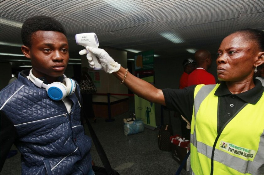 A traveler leaving Nigeria is screened for signs of Ebola infection.