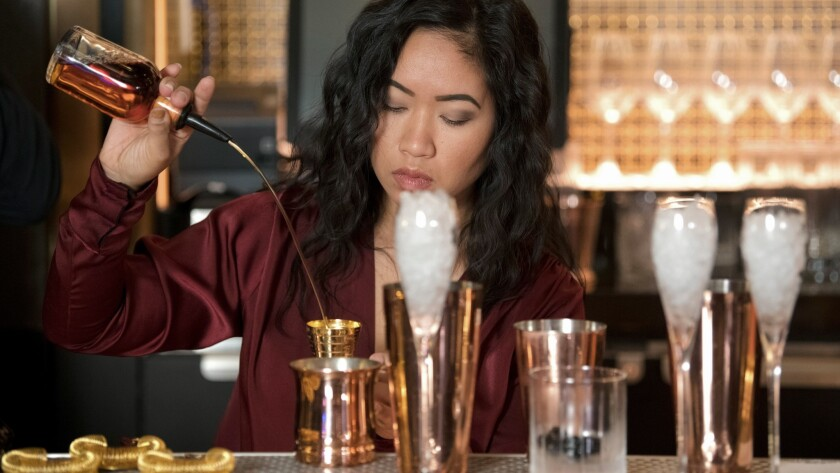 Rosina bartender Sarah is seen during filming for an ad for Plan for Vacation Day Thursday, January