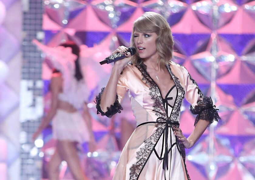 Singer Taylor Swift performs at the Victoria's Secret fashion show in London, Tuesday, Dec. 2, 2014. (Photo by Joel Ryan/Invision/AP)