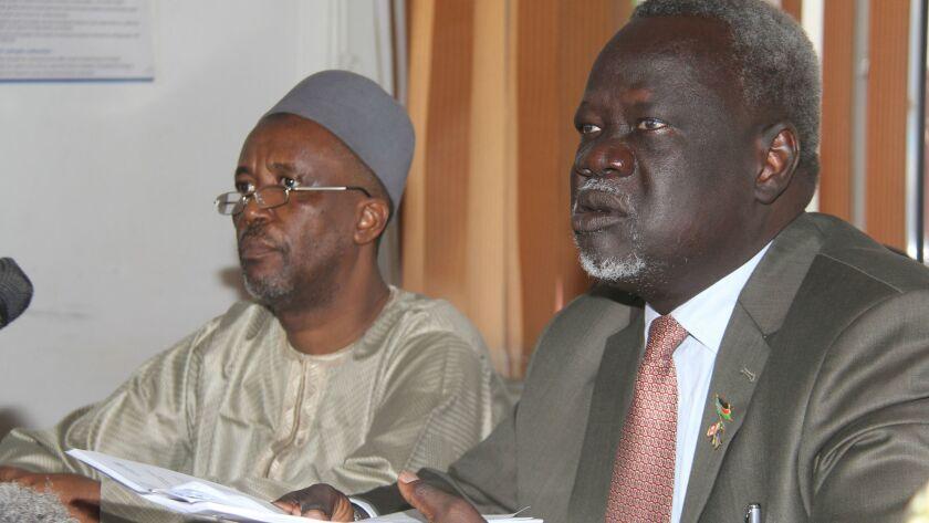 South Sudan Health Minister Riek Gai Kok, right, and World Health Organization official Abdulmumini Usman at a news conference in Juba, South Sudan, on June 2.