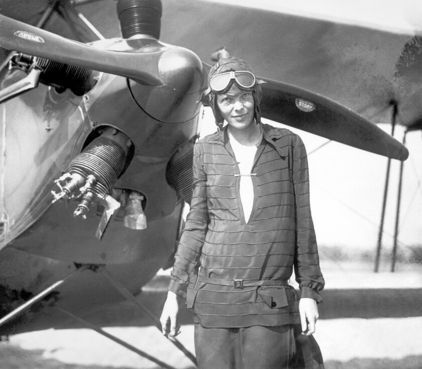 Amelia Earhart stands in front of her airplane on Sept. 11, 1927.